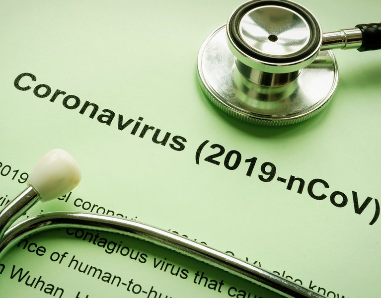 Coronavirus 2019-nCoV or Wuhan pneumonia virus and stethoscope.