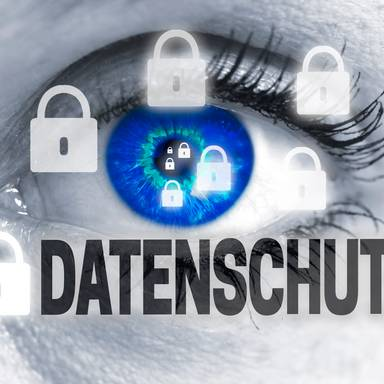 datenschutz (in german data protection) eye looks at viewer concept